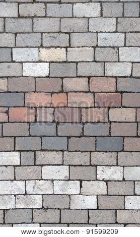 Pavement Bricks Of Grey And Pinkish Colors As Background.