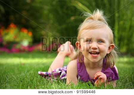 Young child playing outdoors