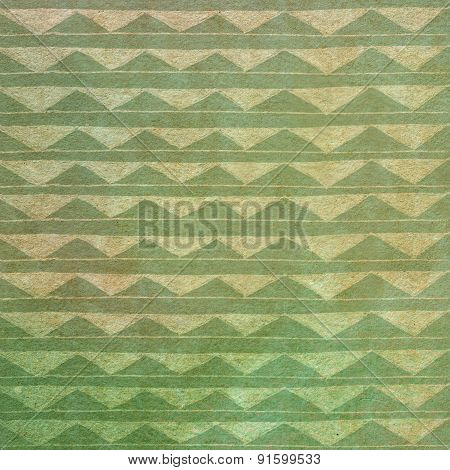 Handmade Ornament Triangle Prints On Green Paper Background - Abstract Graphic Design
