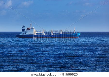 ship and motorboat in a calm ocean