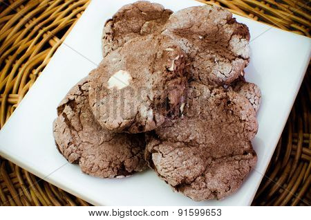 Chocolate with almond slices cookies in powdered sugar