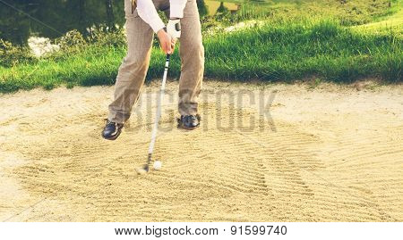 Businessman Golfer In Sand Trap