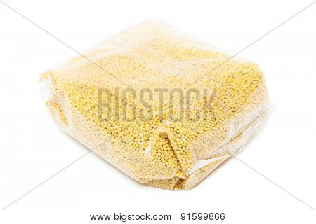 millet in the package on a white background