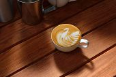 stock photo of latte  - Cup of cafe latte art on the wooden table - JPG