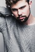 image of pullovers  - Portrait of  young man in gray pullover - JPG