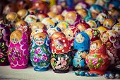 picture of doll  - Colorful Russian nesting dolls matreshka at the market. Matrioshka Nesting dolls are the most popular souvenirs from Russia. ** Note: Visible grain at 100%, best at smaller sizes - JPG