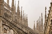 image of stone sculpture  - Detail view of stone sculptures on roofs of Duomo Milano Italy - JPG