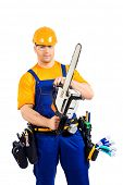 picture of man chainsaw  - Male construction worker in uniform working with chainsaw - JPG