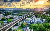image of high-speed train  - hong kong urban downtown and sunset speed train - JPG