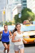 Постер, плакат: Running workout in New York City Urban runners people jogging in busy street in New York NYC Young