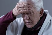stock photo of high fever  - Elderly man with infection and high temperature - JPG