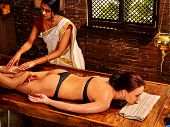 picture of ayurveda  - Young woman having leg Ayurveda spa treatment - JPG