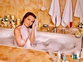 picture of bubble-bath  - Woman relaxing at water in bubble bath on towels background - JPG