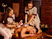 image of massage oil  - Female couple  are making oil massage by man  in spa treatment  - JPG