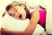 foto of yawning  - Pretty young girl yawning while waking up - JPG