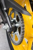 foto of lube  - Enduro motorbike wheel and chain - JPG