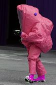 pic of biological hazard  - man with yellow protective gear against biological risk - JPG