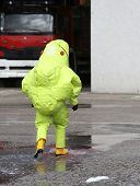 foto of biological hazard  - man with yellow protective gear against biological risk - JPG