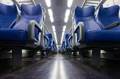 foto of passenger train  - Perspective view of seats from the aisle inside a passenger train - JPG