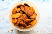 stock photo of compose  - Indian dessert or biscuits made from deep fried dough composed of wheat flour - JPG