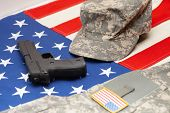 stock photo of handgun  - US flag with handgun and US army uniform over it - JPG