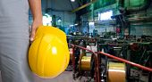 picture of industrial safety  - Worker with safety helmet at industrial factory - JPG