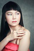 image of shy girl  - Shy Asian girl smiling - JPG