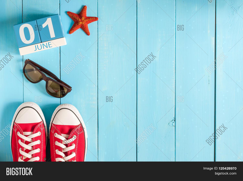 June 1st. Image of june 1 wooden color calendar on blue background. First sum...