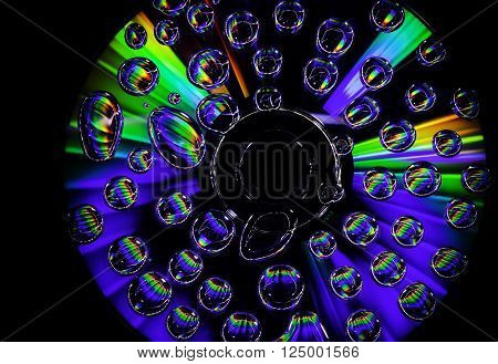 CD with great lights, flares and waterdrops on the surface on black background