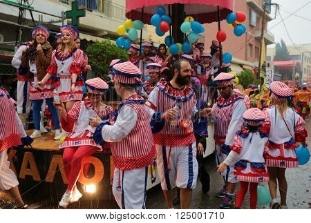 RETHYMNO, CRETE - MARCH 13, 2016: Torrential rain puts a dampener on the final half-hour of the Carnival Parade in Rethymnon, Crete, one of the largest celebrations of its type in Greece.