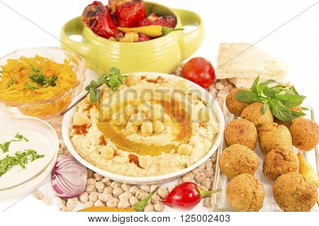 Hummus with mint and the fresh vegetables isolated