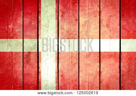 Denmark wooden grunge flag. Denmark flag painted on the old wooden planks. Vintage retro picture from my collection of flags.