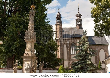 KUTNA HORA, SLOVAKIA - JULY 8, 2009: Sedlec Ossuary (aka Church of Bones) beneath the Cemetery Church of All Saints, contains over 40,000 skeletons whose bones are artistically arranged as decorations