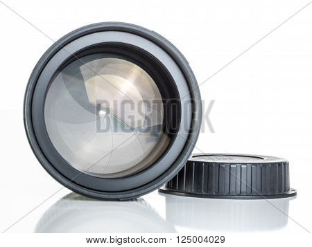proffesional photography lens close up over white background