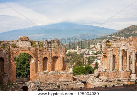 Detail of the greek amphitheater with the Etna Volcano and Taormina in the back in Taormina city Sicily Italy