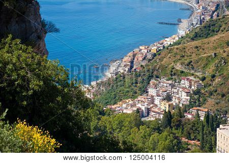 Panoramic view of Giardini Naxos bay from Castelmola Taormina in Sicily Italy