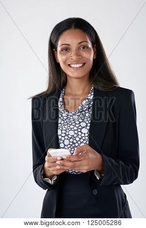 beautiful latino hispanic woman texting on her mobile cell phone smartphone in corporate office attire