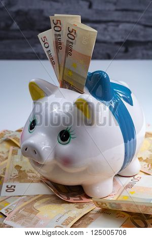 Piggy bank and euro banknotes - sucess of money laundering business concept