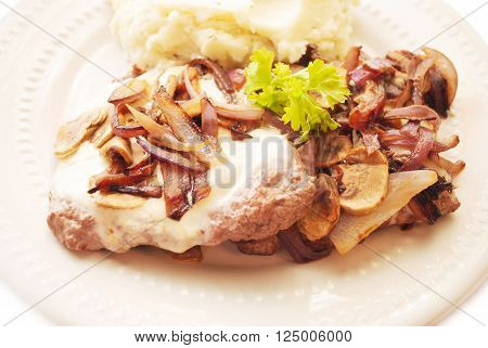Cube Steaks Served with Cheese Mushrooms & Red Onion
