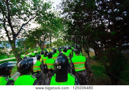 Quito, Ecuador - April 7, 2016: Police leaving marching peaceful anti tax march in Shyris Avenue with anti Rafael Correa goverment protestors.