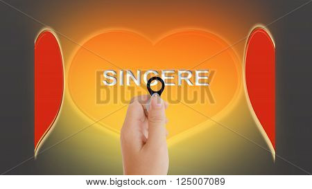 Beautiful Big Golden And Red Heart And Text Sincere With Women Hand Taking Focus Lens