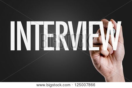 Hand writing the text: Interview