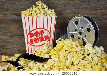Vintage movie reel and film in popcorn