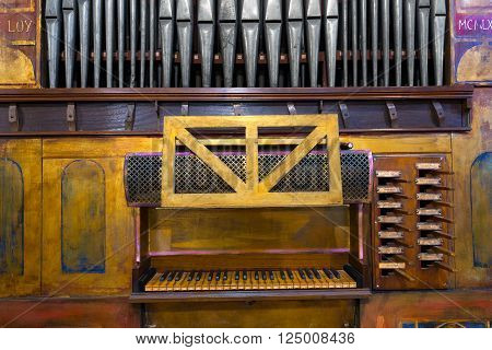 Detail of an ancient pipe organ in an Italian church