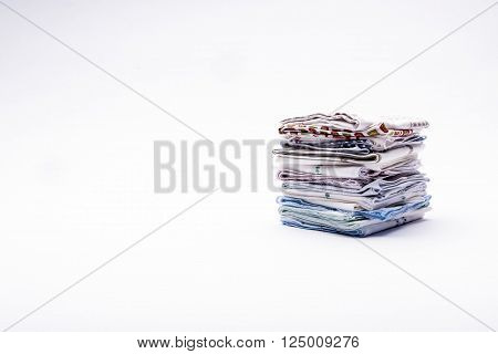 a stack of folded handkerchiefs on a light background