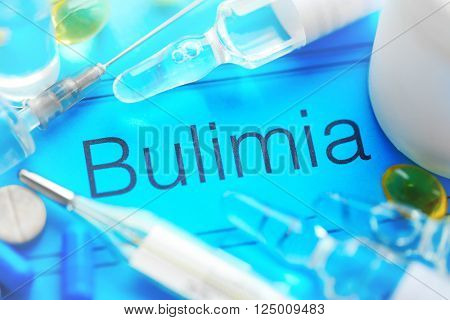Medicines and Bulimia diagnosis written on paper closeup