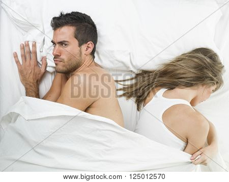 non communicative offended couple goes to sleep unhappy