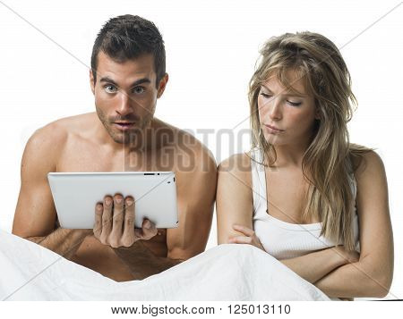 angry woman while his partner is watching a tablet