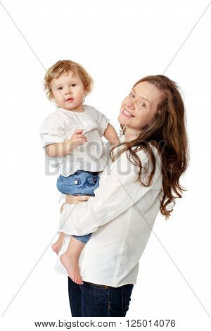 Mom holding the baby in her arms in white shirts and jeans on a white background isolated