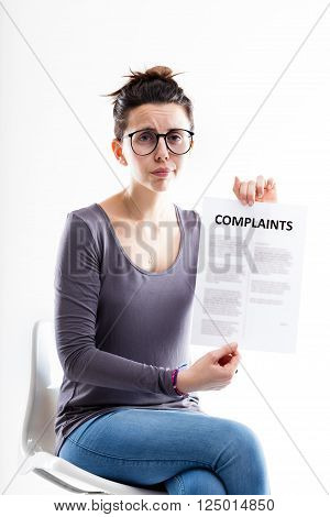 Sitting Woman Showing A Form With Complaints